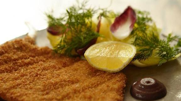 Chef Fernando Navas reviews Heritage pork milanesa, endives, dill and grape must mustard at Balvanera