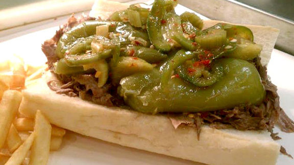 Chef Tony Priolo reviews Italian beef sandwich at