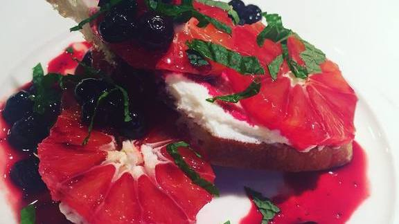 Chef Gayle Pirie reviews Breakfast crostini, fromage blanc, blood oranges, wild huckleberries at Foreign Cinema
