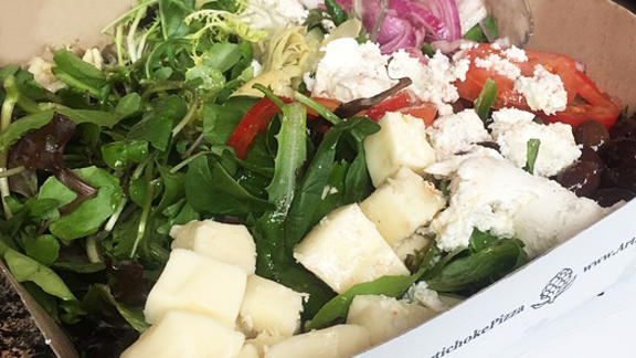 Boxed salad at Artichoke Basille's Pizza & Brewery