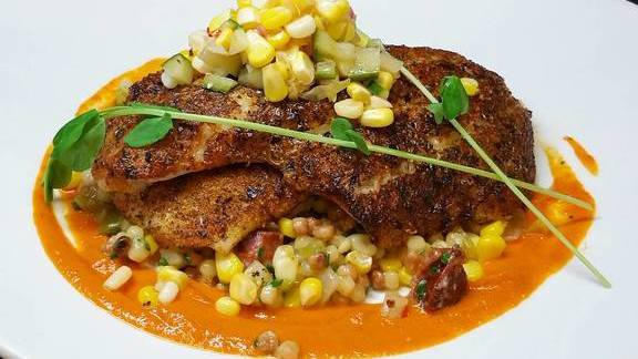 Yellowtail sole with chorizo and corn fregola, and tomato vinaigrette at Farm Shed Dinners