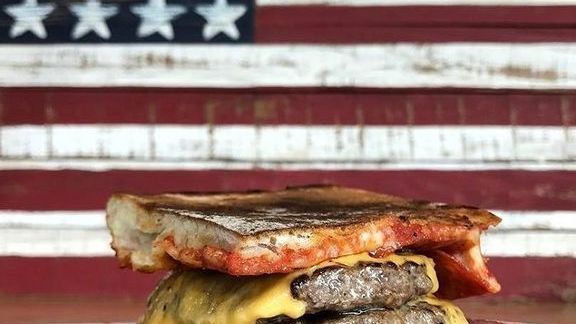 Pizzurger: Pizzaburger with melted cheddar at The Company Burger