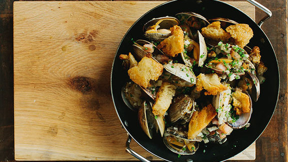 Chef Anne Quatrano reviews Garlicky tiny clams & pork belly at The Optimist