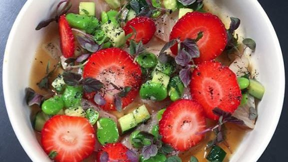 Yellowtail sashimi, fava beans, strawberries, white soy and brown rice vinegar at Liholiho Yacht Club