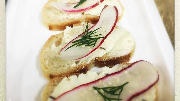 Simple canapé with radishes, lavender, dill, and seasame at The Hive at 21c