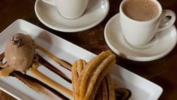 Churros, dulce de leche, and hot chocolate at Hugo's