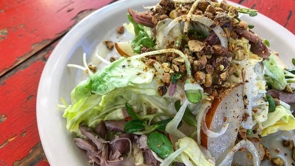Duck confit salad with butterhead lettuce, sprouts, pistachio, smoked pear and ginger vinaigrette at Lucy's Fried Chicken