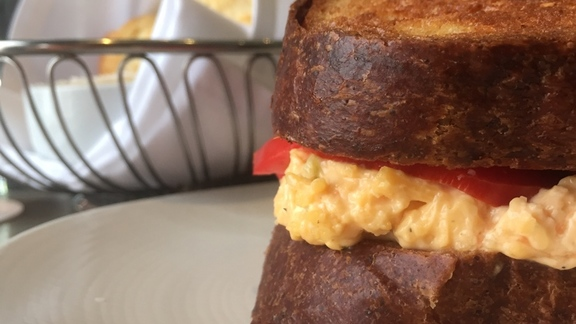 Chef Rebecca Masson reviews pimento cheese grilled cheese sandwich at