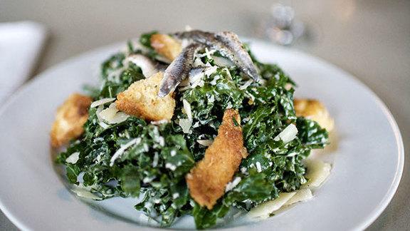 Chef Kathy Casey reviews Kale Caesar salad at Skillet Diner