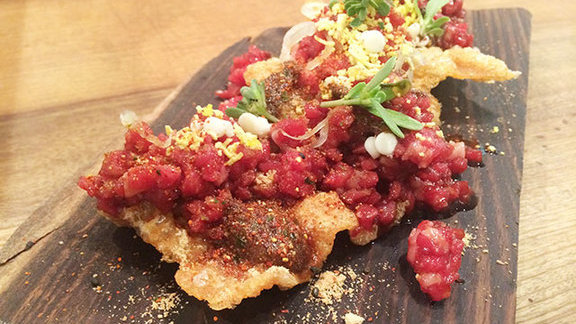 Chef Greg Dunmore reviews Beef tartare with natto crisp at