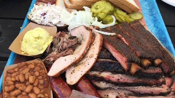Barbecue plate with beans, sausage, egg salad, pickles, slaw, and white bread at Franklin Barbecue