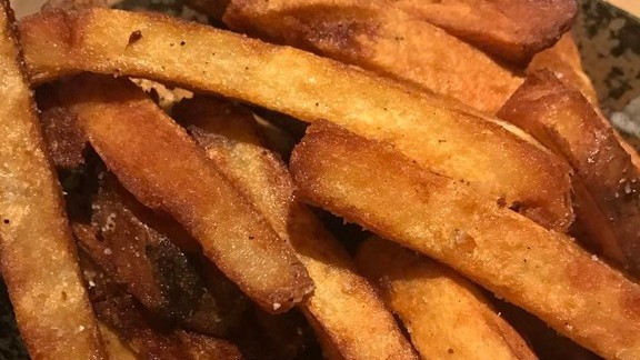 Chef Dave Danhi reviews French fries at The Bellwether