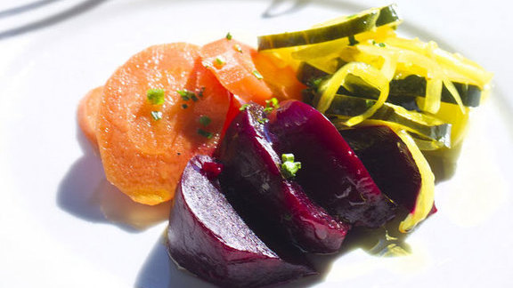 Chef Michael Sichel reviews Housemade selection of pickled vegetables at Sylvain