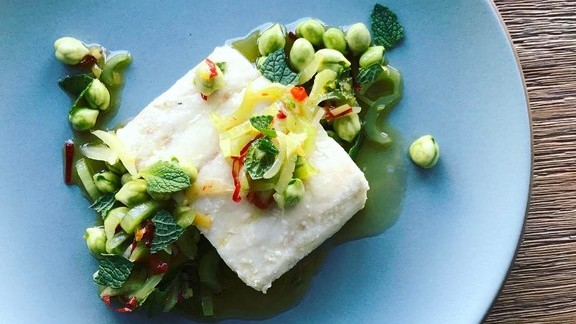 Olive oil poached halibut, garbanzo, celery, chili, mint, preserved meyer at Fiorella