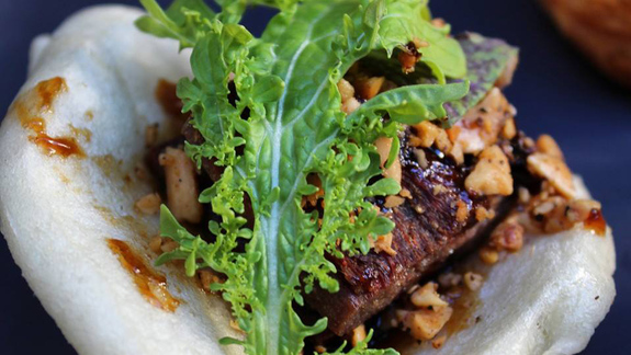 Chef Larry Finn reviews Steamed bun with lamb belly at