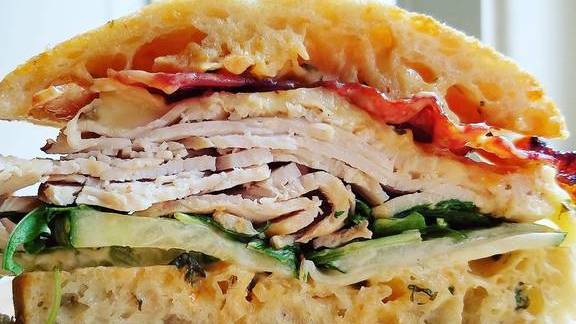 Chef Jacob Hunter reviews Turkey sandwich with cucumber, chipotle aioli, Swiss cheese, bacon, and arugula on ciabatta  at Dirty South Deli