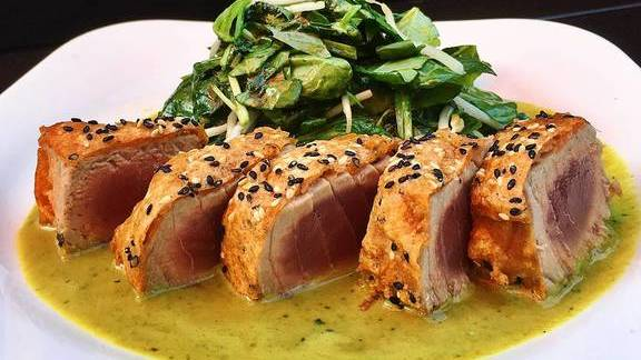 Ahi tuna, watercress, and ginger cilantro coconut sauce at Malai Thai Vietnamese Kitchen & Bar