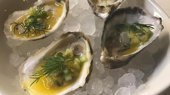 East and West Coast oysters with passion fruit and horseradish at Il Buco