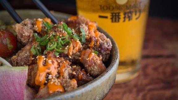 Rice bowl with karage, furikake, and garlic sauce.  at Ichicoro