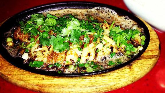Sizzling fish at OB Noodle House & Sake Bar