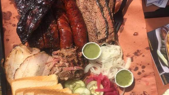 Barbecue plate with pickled onions, slaw, and bread at Lewis Barbecue