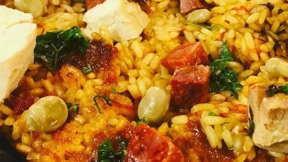 Chef Mario Batali reviews Paella with chicken, saffron rice, pork and beans at La Sirena Ristorante