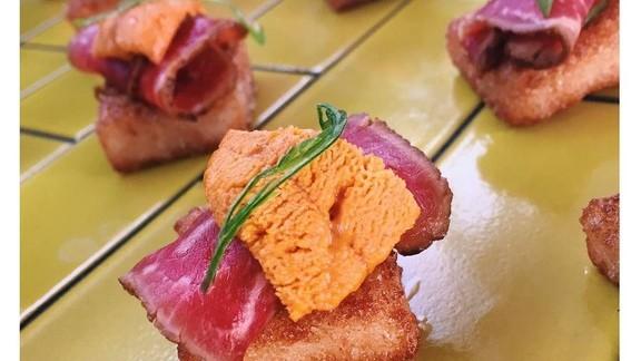 Beef tataki with sea urchin, daikon cake and oyster-nasturtium emulsion at Otium