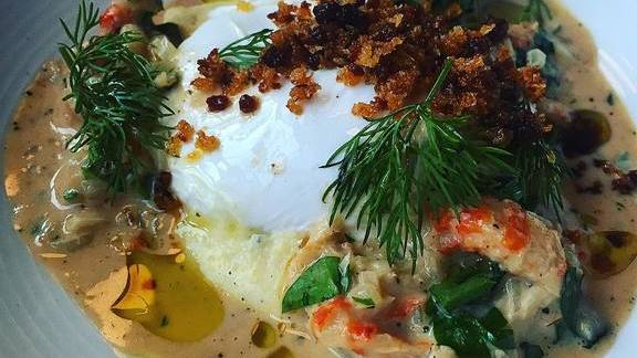 Poached duck egg, creamed crawfish, polenta, and bread crumbs  at Brasserie Beck