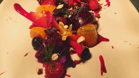 Pickled strawberry, tart blueberry, almond, shattered blackberry, bachelor blossom, nasturtium flower at Wolf