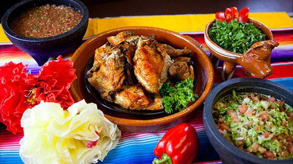 Half broiled chicken at Pollos Maria