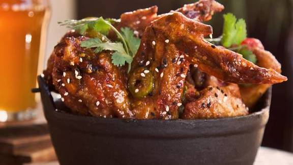 Thai wings with sesame seeds at Malai Thai Vietnamese Kitchen & Bar