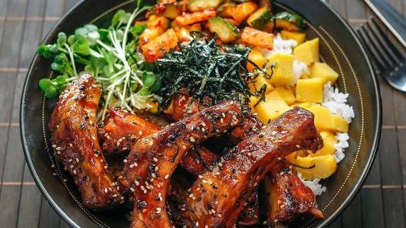Korean Barbecue Bowl with Sticky Ribs. Cucumber daikon panchan, tamago, daikon sprouts, shredded nori at Pacific Catch