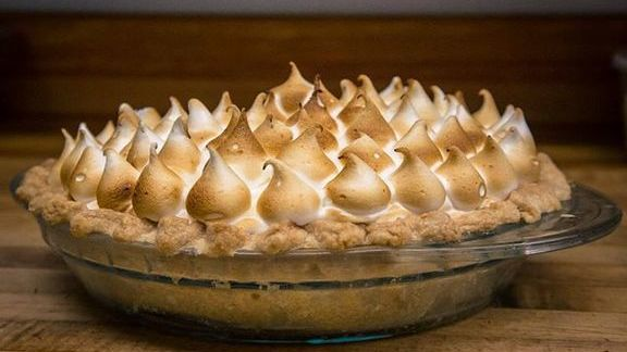 Citrus meringue with a custard consisting of lemon, lime, yuzu and blood orange juice. Topped with a lightly toasted meringue.  at Rainier Club