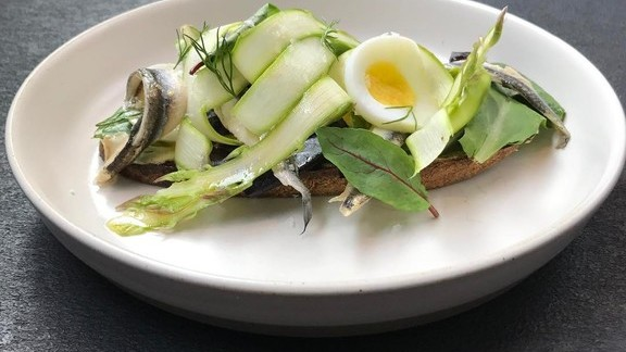 Asparagus tartine, green garlic mayo, marinated anchovies, hen egg at Little GEM