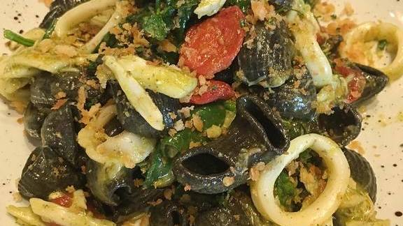 Squid ink pasta, Maryland crab, calamari, roasted tomatoes and spicy bread crumbs at Alta Strada