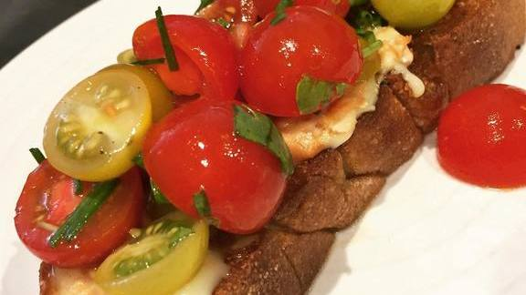 Chef Ted Hopson reviews Sautéed bread, époisses cheese, marinated cherry tomatoes, lovage at The Bellwether