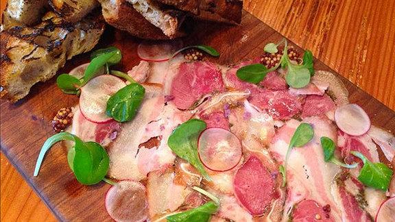 Chef Albert Di Meglio reviews House-made porchetta di testa at The Lark
