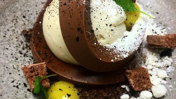 Dark milk chocolate, earl grey ice cream, black lime and sudachi dessert at Boka
