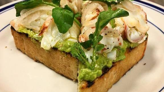 Lobster avocado toast with pickled shallots, watercress, and black pepper at The Salt Line