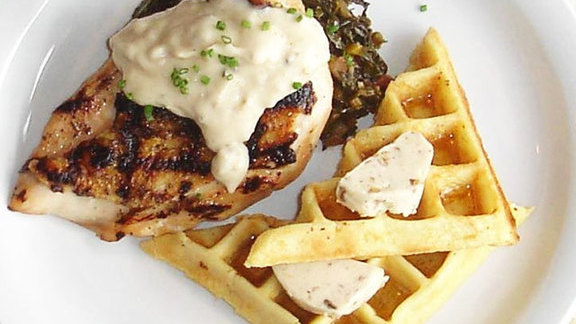 Grilled organic chicken w/ malted waffles at Cowbell