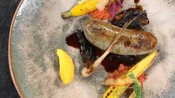 Wood-grilled rabbit and ramp sausage, morel mushroom jus, carrot and beet crumble at The Market Place Restaurant