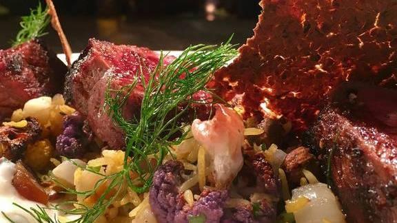 Chef Dean Fearing reviews Grass fed sirloin, saffron rice, cauliflower, fennel, charred dates, pistachios at Fearing's