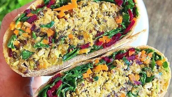 Veggie burger wrap with vegan quinoa, kale, carrots and purple cabbage at Akasha