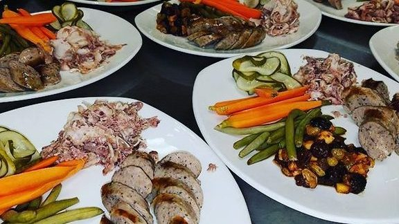 Head cheese, garlic white wine sausage, mostardo, lots of pickles at South Congress Cafe