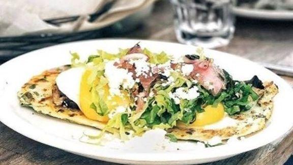 Huarache, spinach, oaxaca cheese, brisket, fried eggs, pickled onion at El Techo de Lolinda