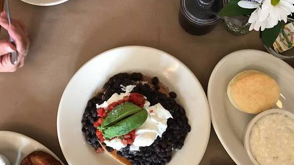 Chef Christine Cikowski reviews Tostada, black beans, sour cream, avocado, and tomato salsa at Hominy Grill