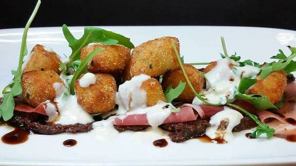 Chef Mike Kelley reviews Gnocchi with prosciutto, Parmesan, fig jam, and bleu cheese at Farm Shed Dinners
