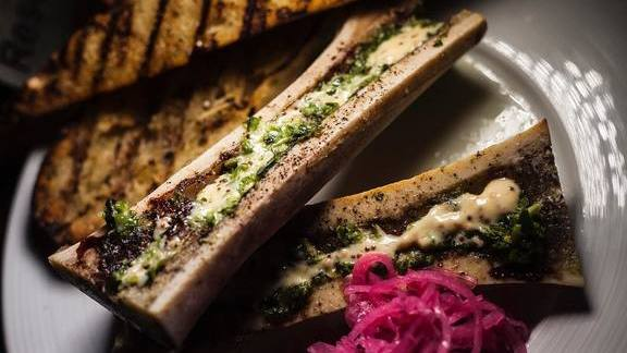 Chef Sammy Monsour reviews Roasted bone marrow with pickled red onions, creole remoulade, horseradish chimichurri and grilled baguette at Preux & Proper