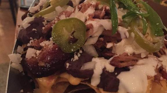 Chef Tiffany MacIsaac reviews Nachos with beef, cheese, queso fresco, jalapenos at Taco Bamba