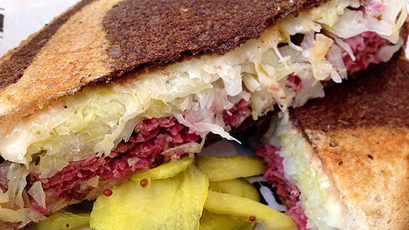 Chef Tenney Flynn reviews Pastrami sandwich at